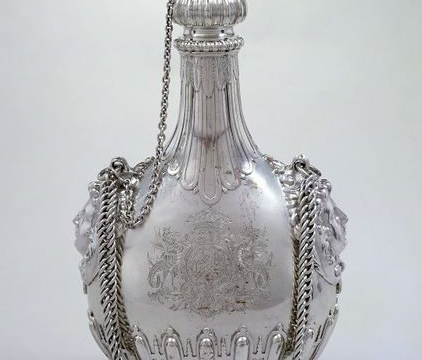 A silver pilgrim bottle with stopper
